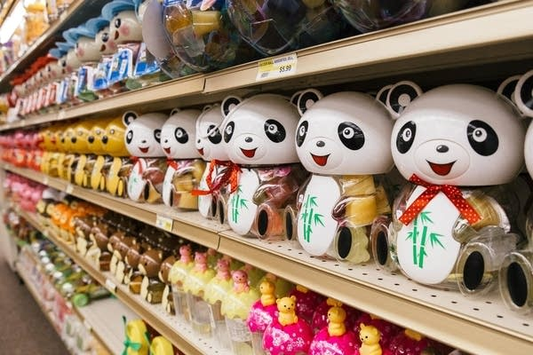 Plastic Panda Bears with gummy candy line the shelves of Ha Tien Market.