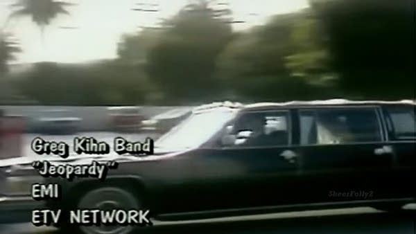"""Video still shot of black 80s limo with text: """"Jeopardy"""" by Gregg Kihn Band"""