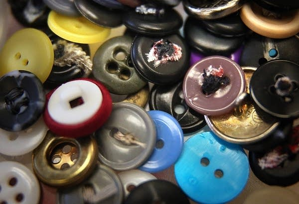 Cathy Jensen's sewing kit includes a wide variety of buttons.