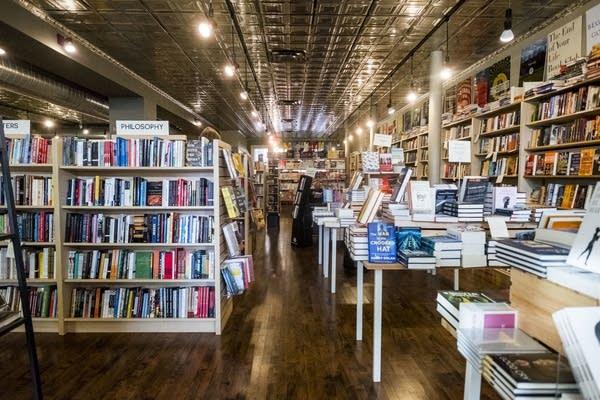 Books line the shelves of Common Good Books