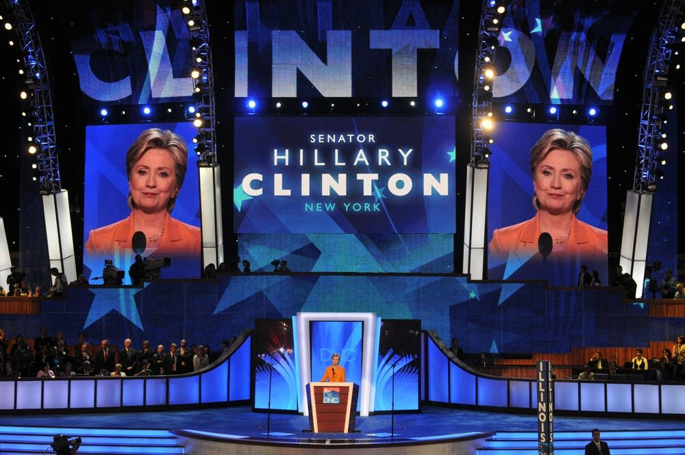 Hillary Clinton takes the podium at the DNC