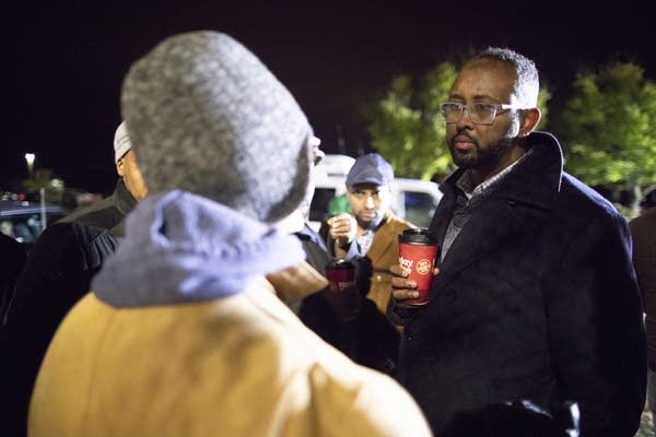 Jaylani Hussein, executive director of CAIR-MN, talks to police.