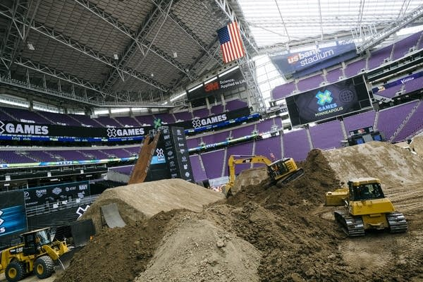 Heavy machinery and dirt fill U.S. Bank Stadium.