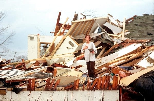 Sarah (Jellif) Davis, then a Gustavus student, pauses in the rubble.