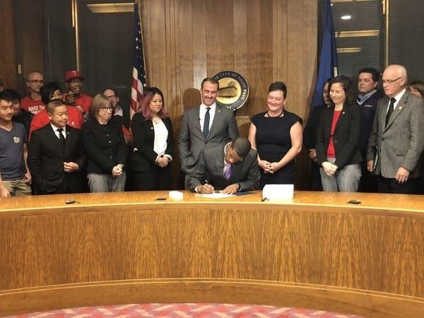 St. Paul Mayor Melvin Carter signs an ordinance