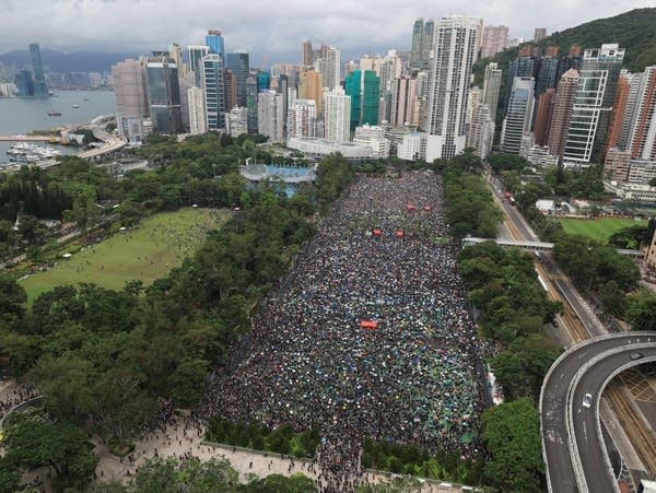 Protesters gather during a rally at Victoria Park in Hong Kong