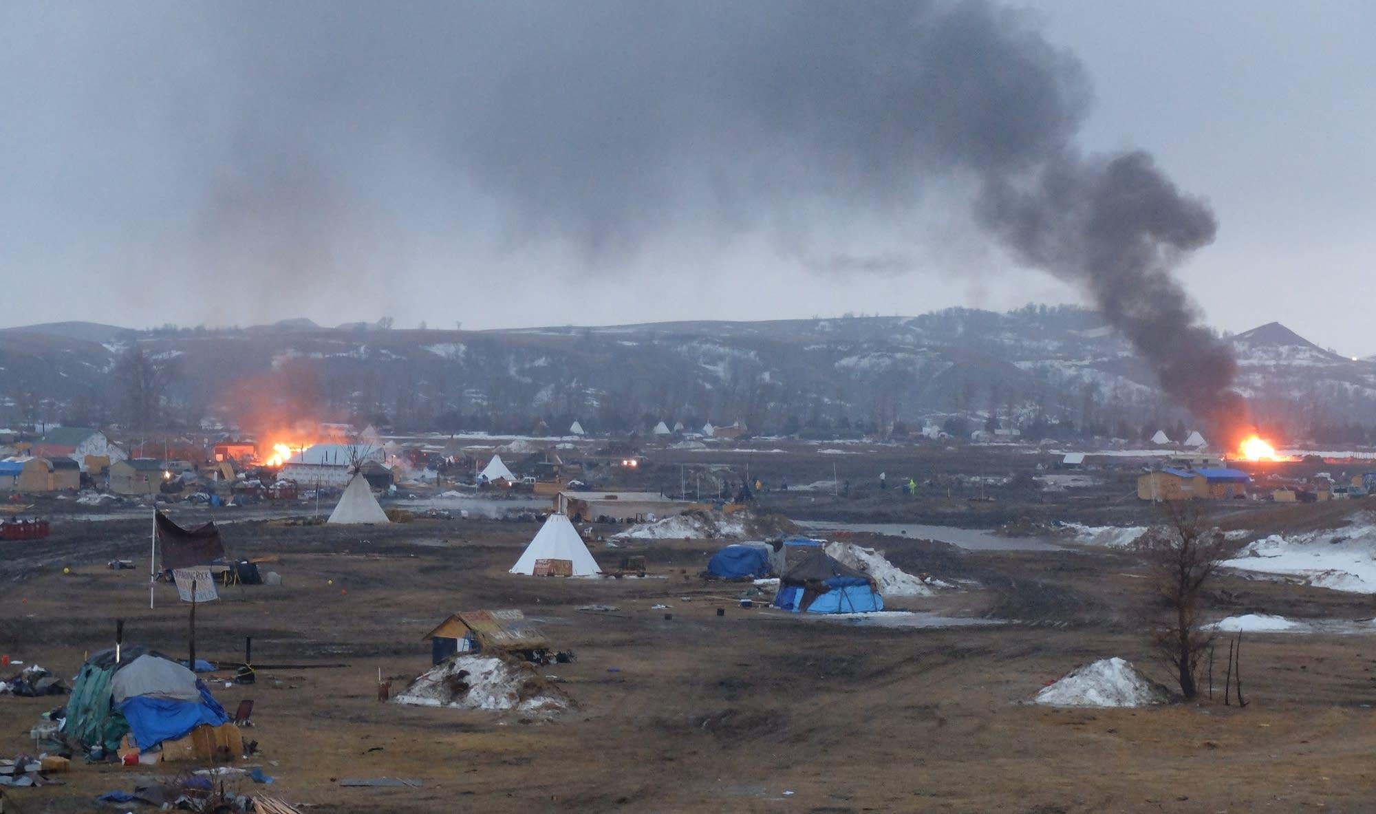 Buildings burn at the Oceti Sakowin camp
