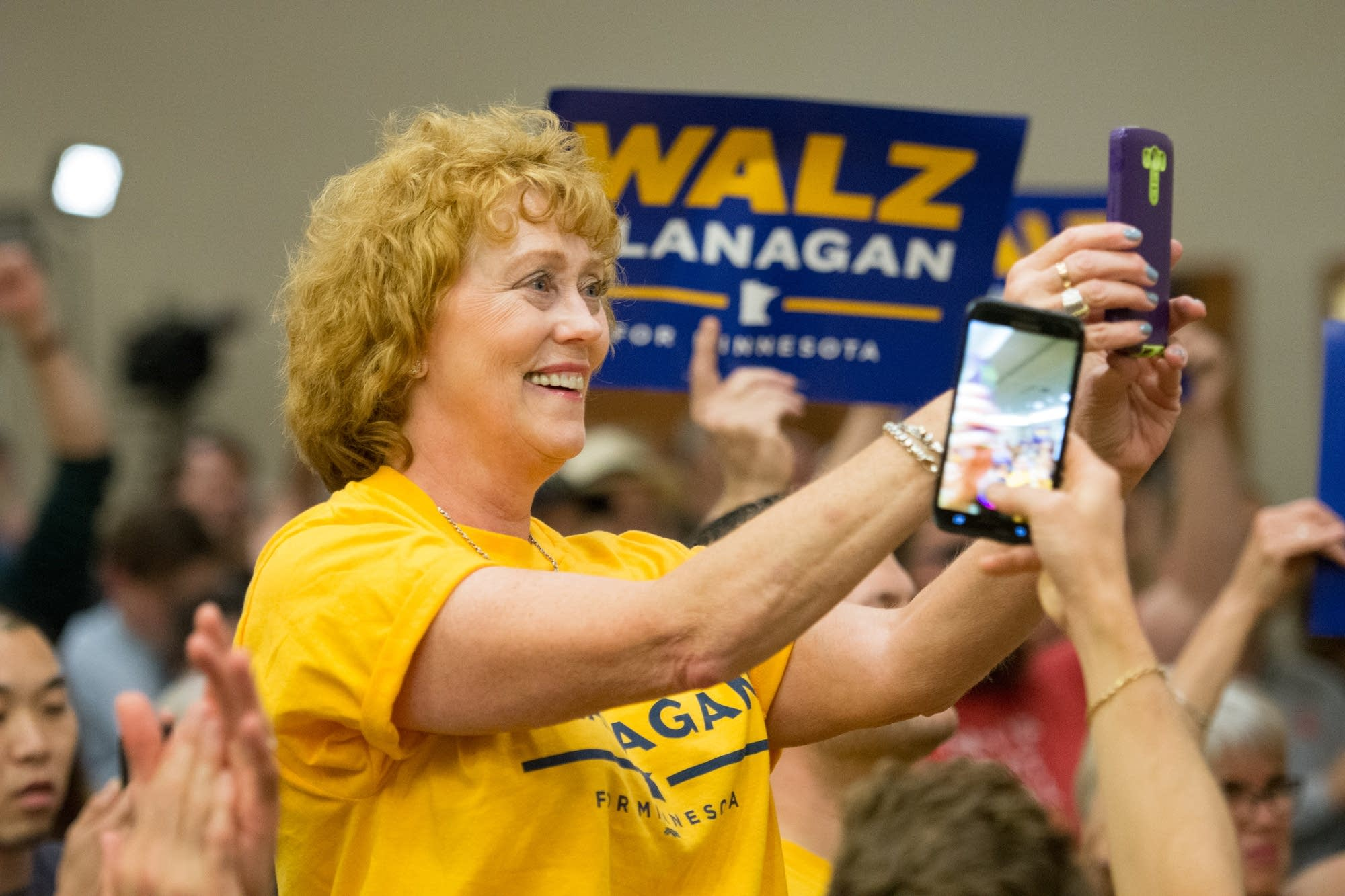 A supporter cheers while gubernatorial candidate Tim Walz speaks.