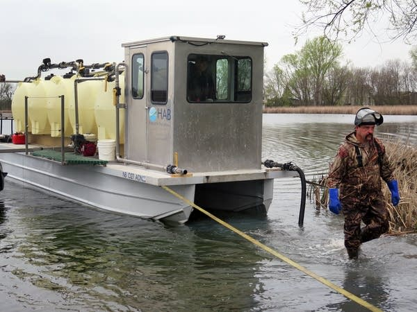 Barge preps for alum treatment.