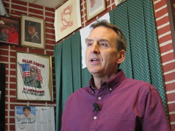 Former Gov. Tim Pawlenty answers reporters' questions