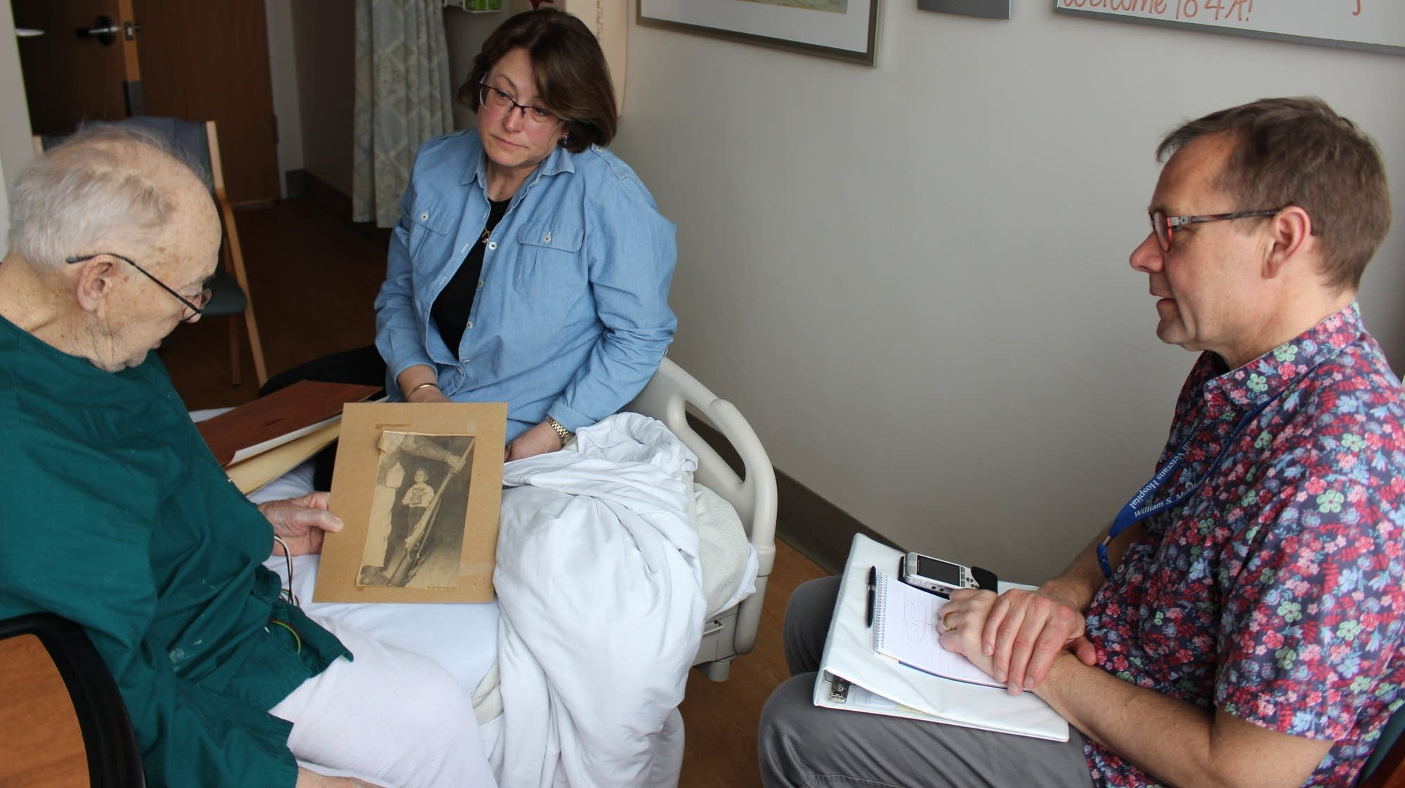 Thor Ringler (right) interviewed Ray Miller innMiller's hospital room