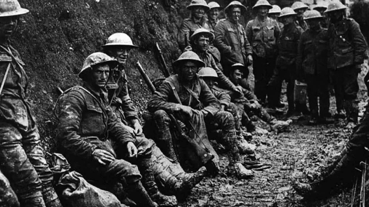British soldiers rest in a trench during World War I.