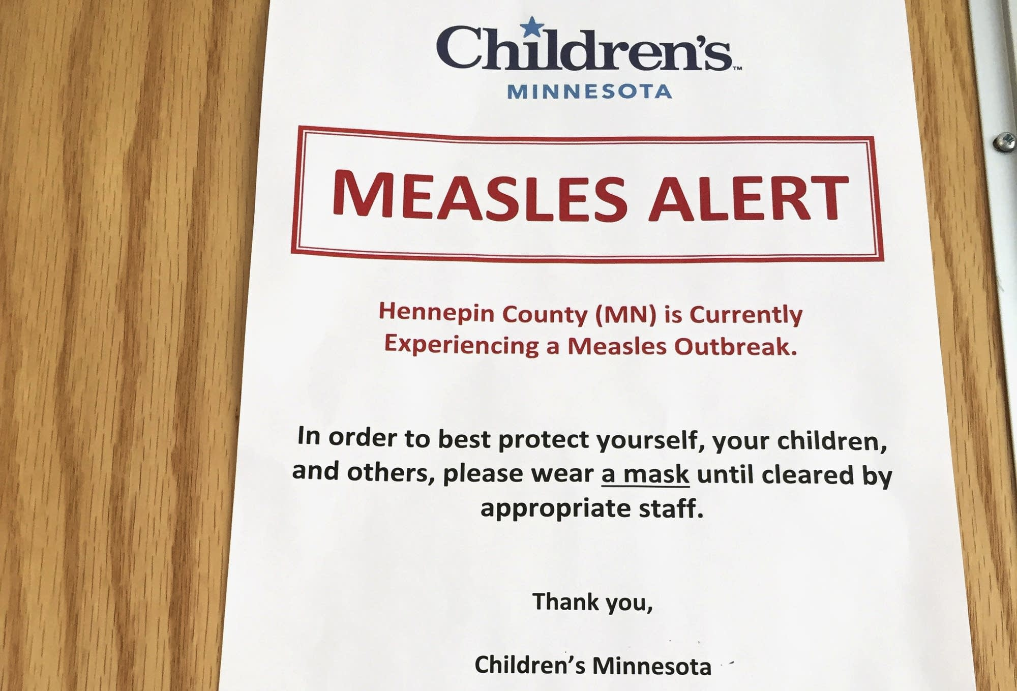 A sign at Children's Minnesota alerts patients to a measles outbreak.