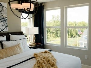 A top-floor bedroom looks out into the Brooks Ridge housing community.