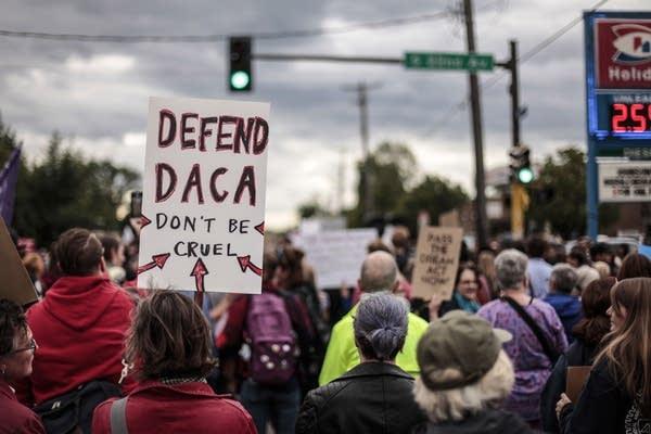 Community members fight President Trump's redaction of DACA.