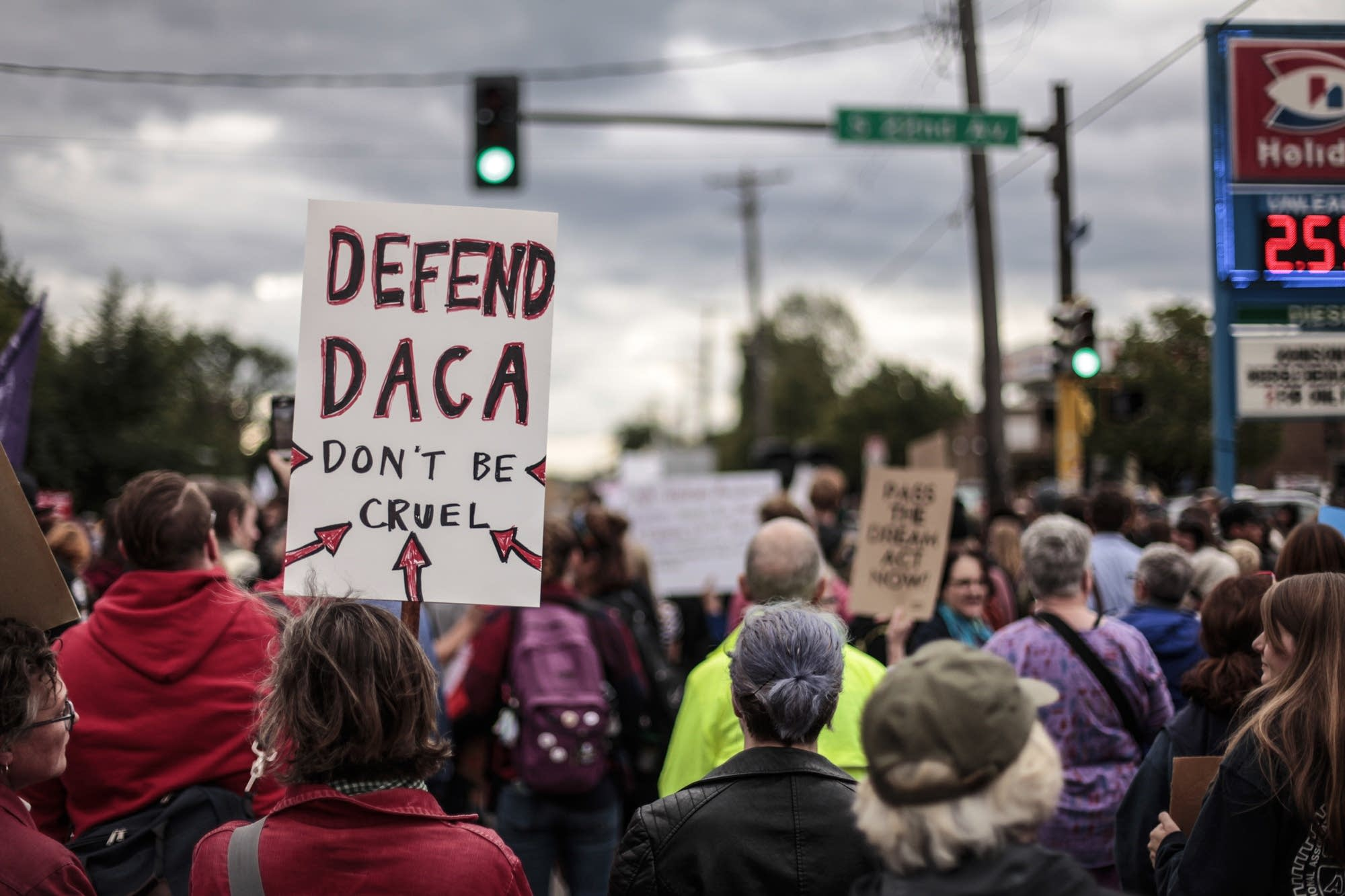 Community members fight President Trump's redaction of DACA.