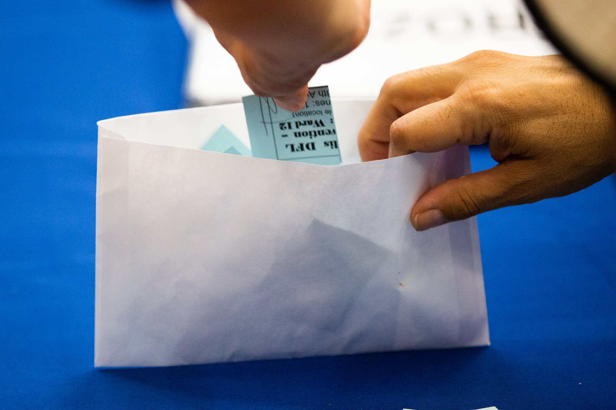 A ballot is put in an envelope.