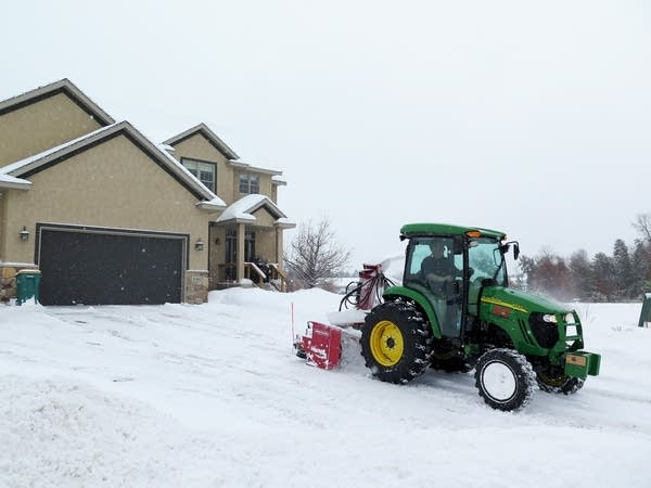 Bob Magstadt with Jared's Lawn Care clears driveways in Baxter