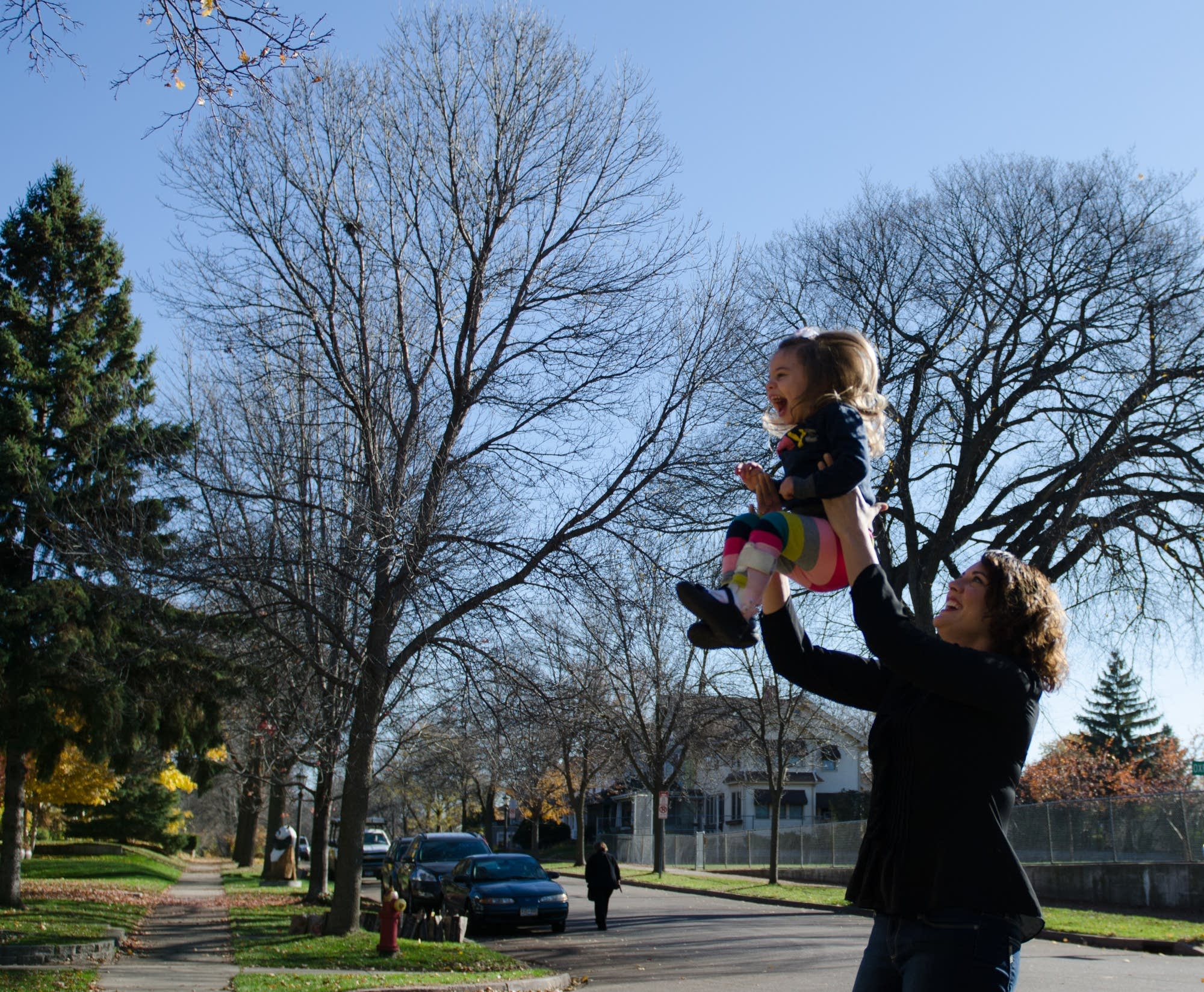 Leah Henrikson and daughter Vivian play outside.