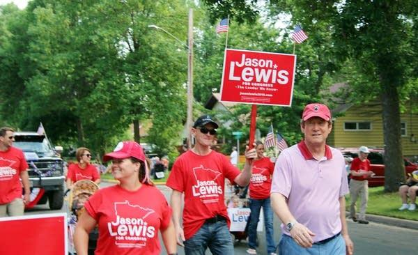 Jason Lewis campaigns at a parade in Farmington.