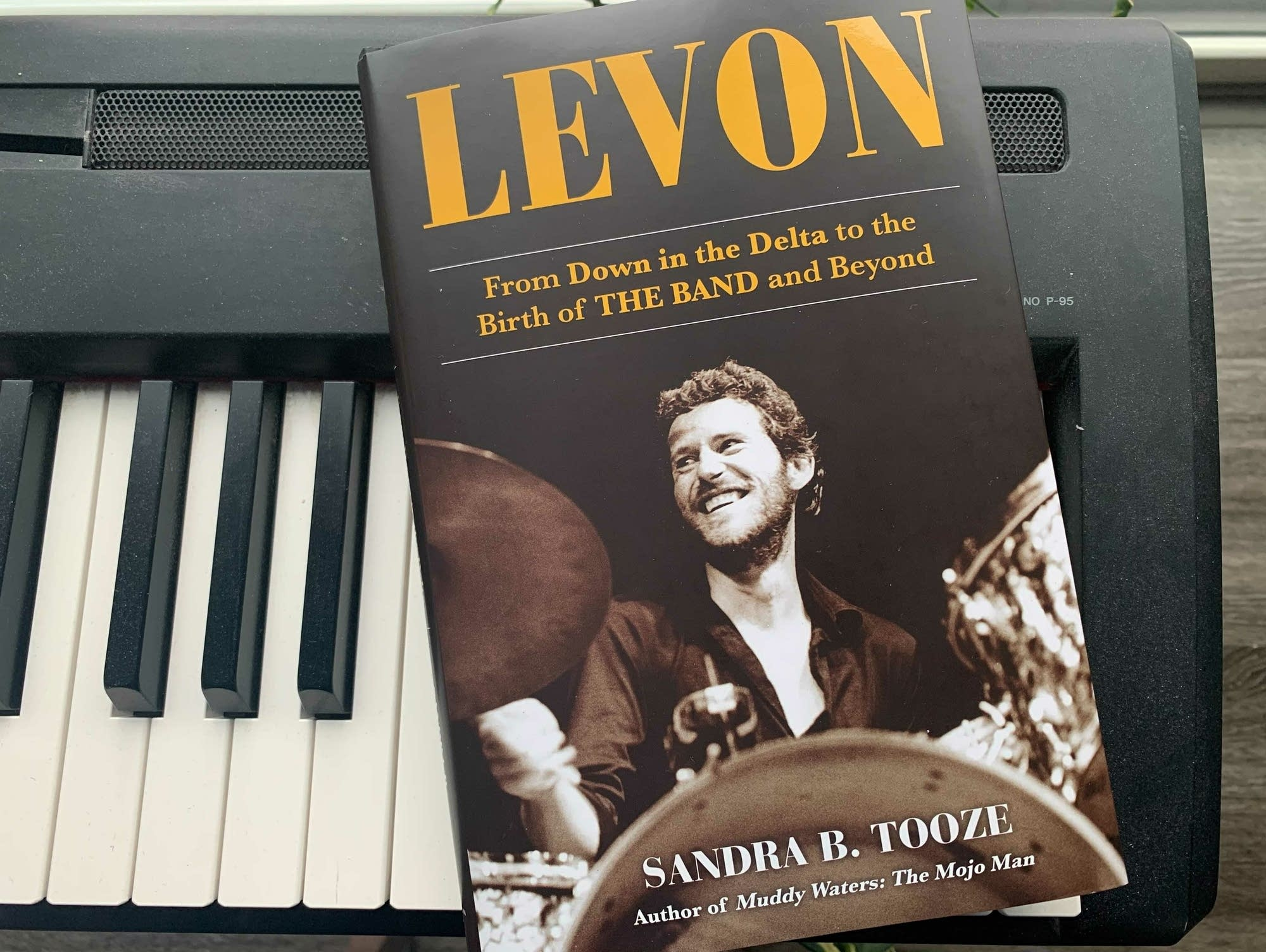 Levon Helm biography resting on keyboard.