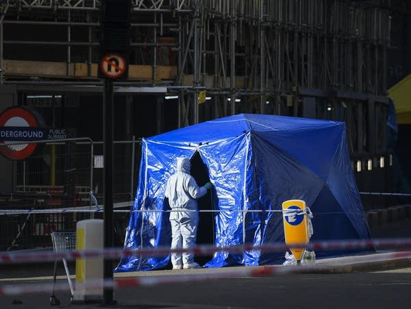 Forensic officers work in central London