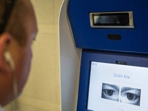 Gregory Osmun completes an iris scan at a Clear kiosk.