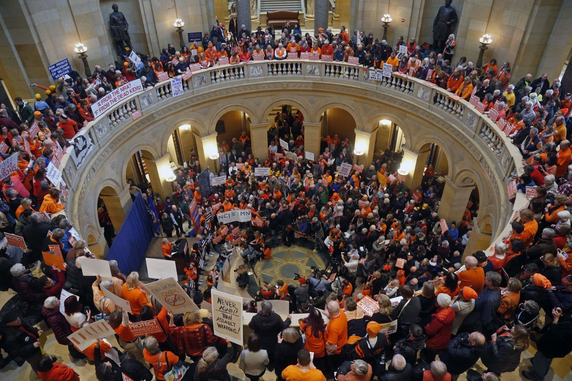Hundreds rally at the State Capitol rotunda against gun violence.