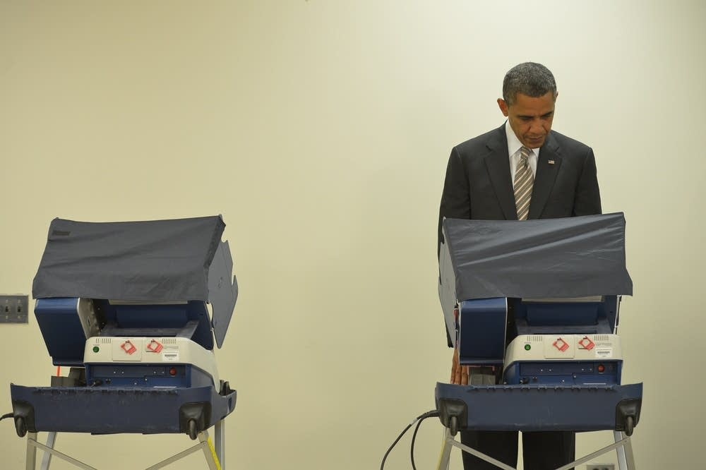 President Barack Obama casts his early ballot