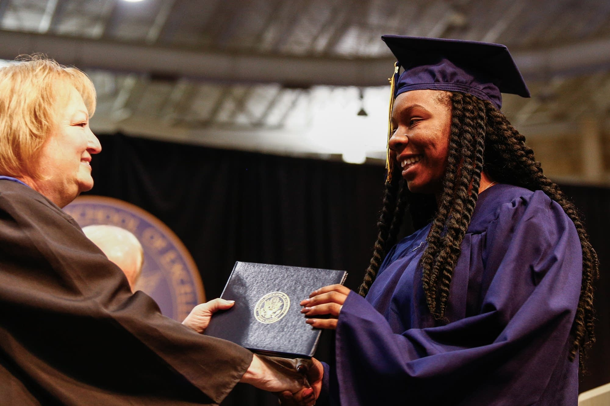 Diamond Syas receives her diploma.