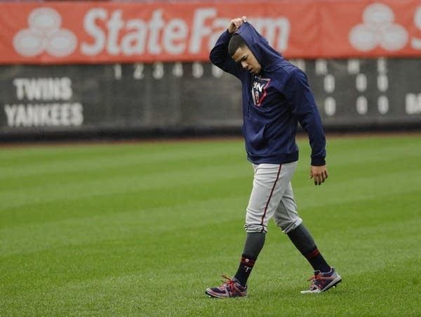 Baseball player walking across field