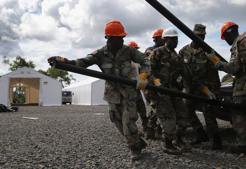 Liberian Army soldiers build treatment center.