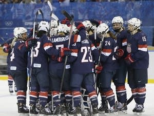 Team USA celebrates their victory over Sweden in the 2014 Olympics