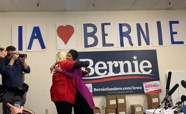 U.S. Rep. Ilhan Omar hugs National Nurses United president Jean Ross.