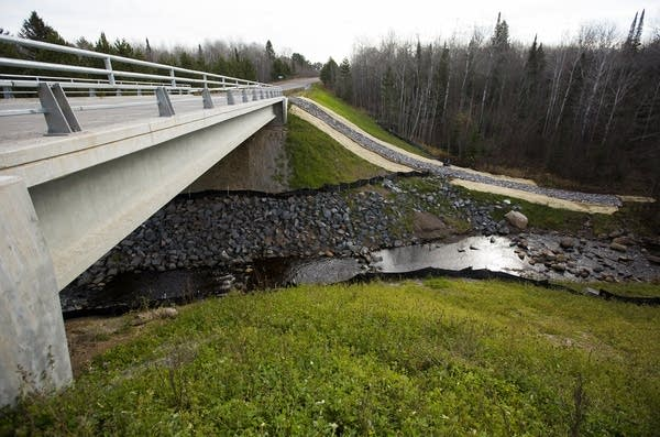 A new bridge replaces a flood-destroyed culvert.