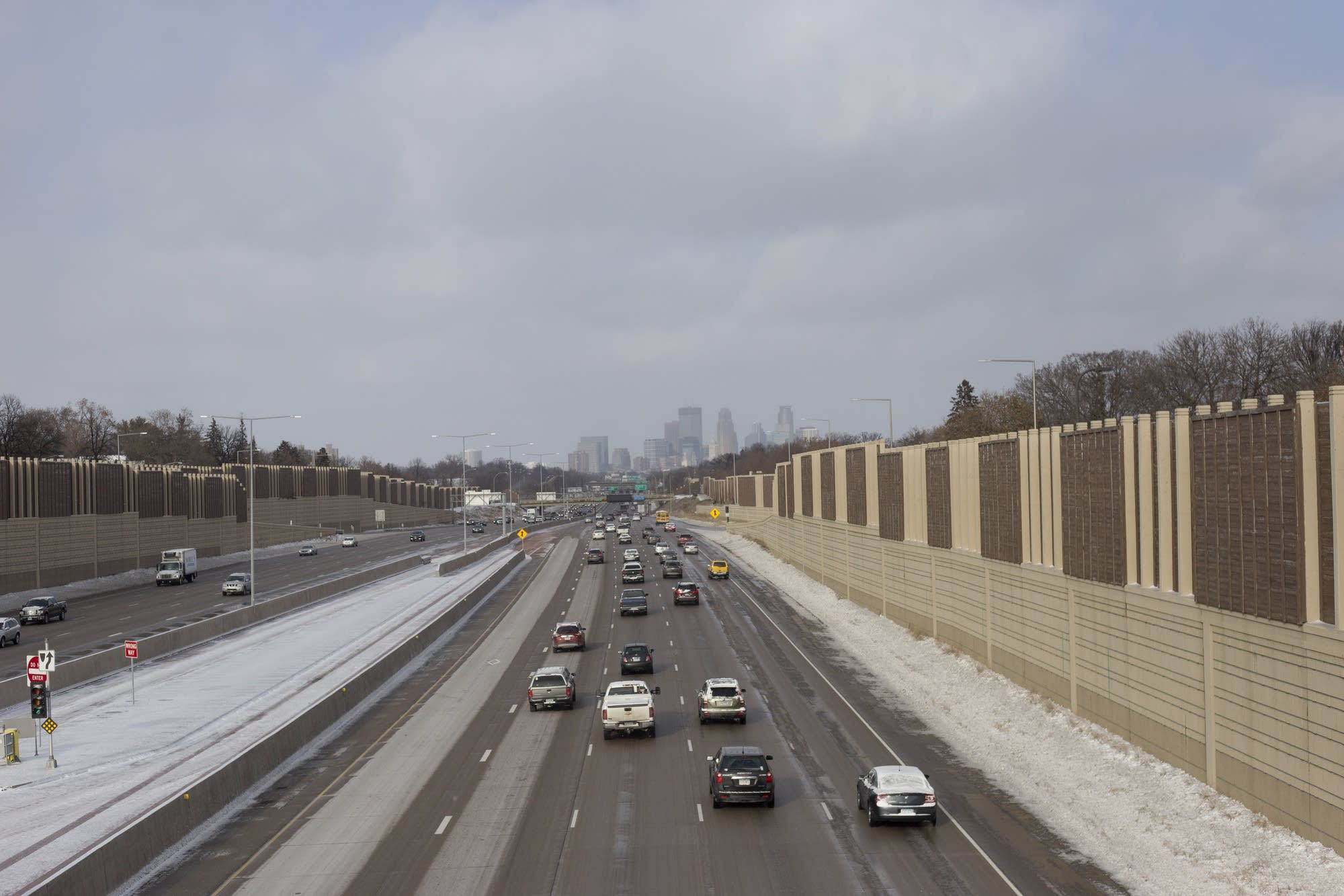 Minneapolis Highway 35W reflects the first heavy snowfall this season.