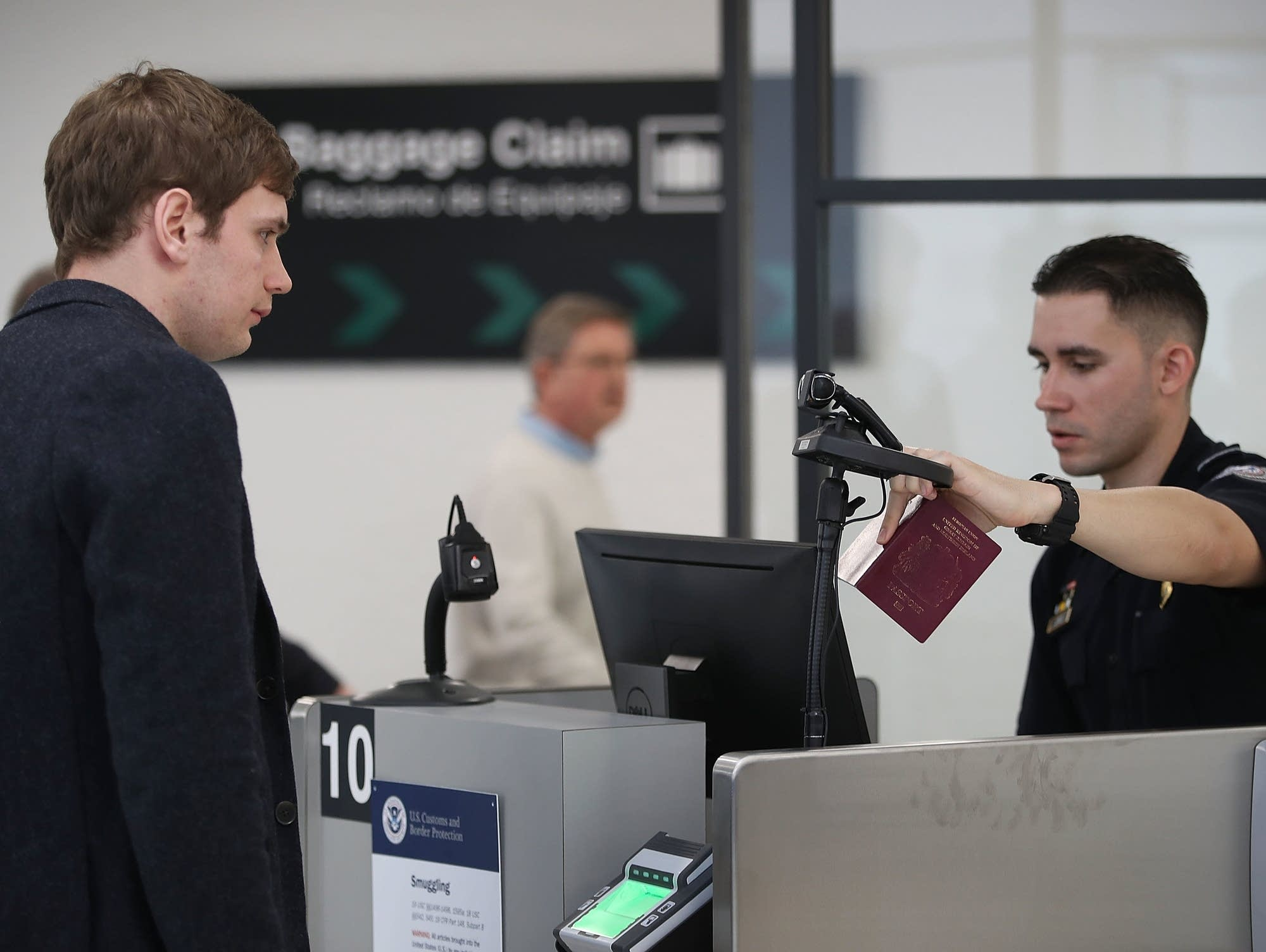 A Customs officer uses facial recognition technology.