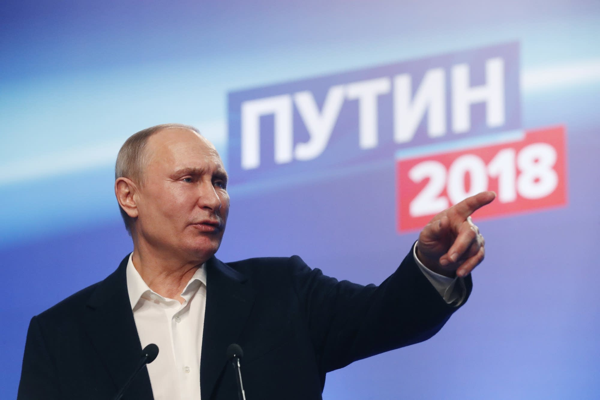 President Vladimir Putin meets with the media at campaign headquarters.
