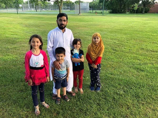 Mawla Saqeb with four of his children in Smith Park
