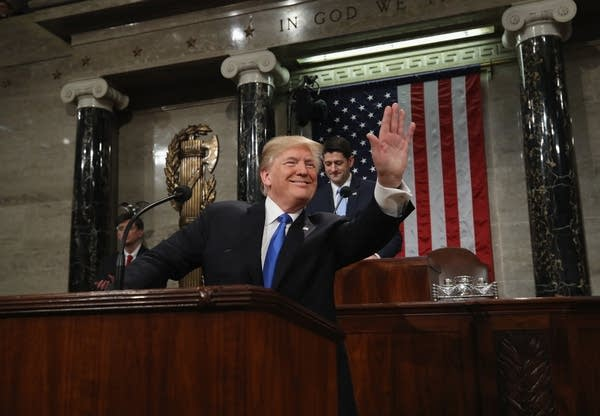 President Trump waves as he arrives during the State of the Union address