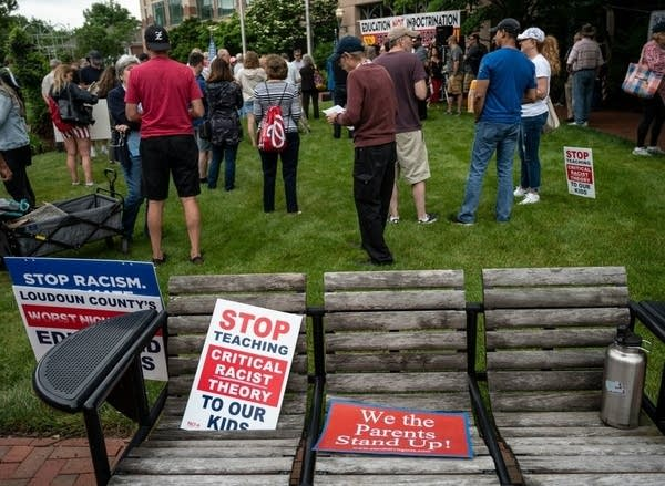 Signs are seen on a bench during a rally.