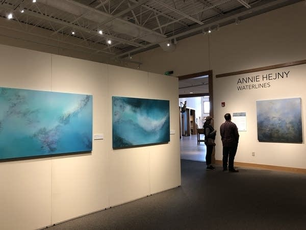 Annie Hejny's exhibition features paintings made with water and sediment.