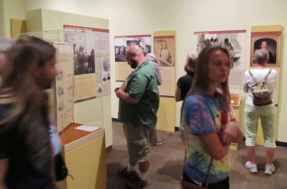 Visitors tour the exhibit