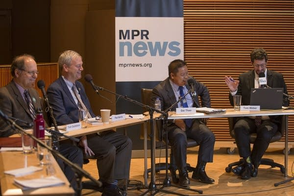 Saint Paul mayoral candidates laugh during the debate on Thursday.