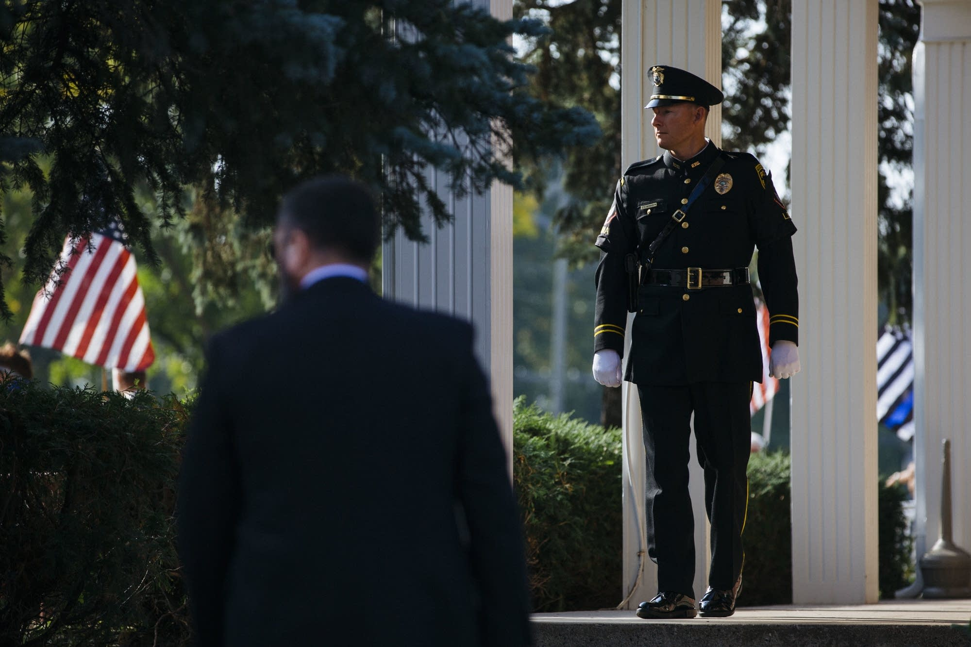 A Hopkins police officer stands on the steps of the church.