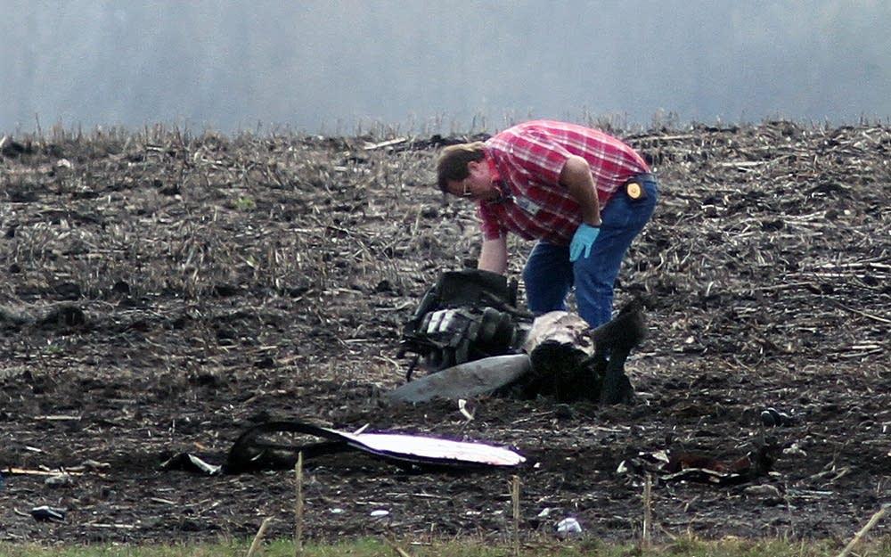 Examining wreckage