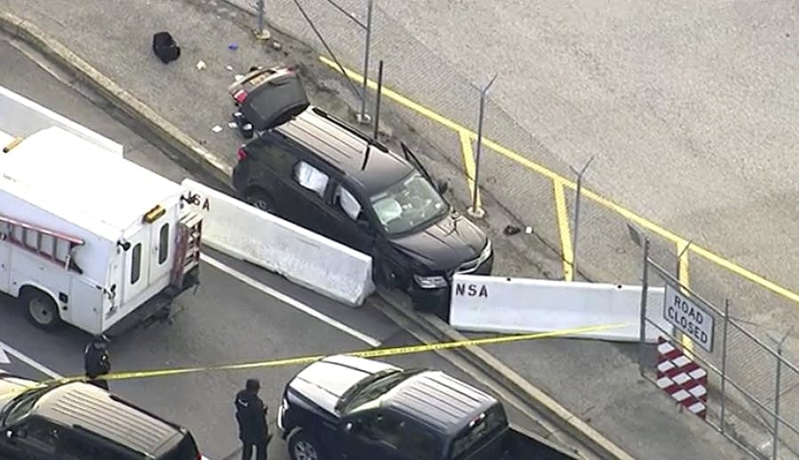 Authorities investigate the scene of a shooting at Fort Meade, Md.