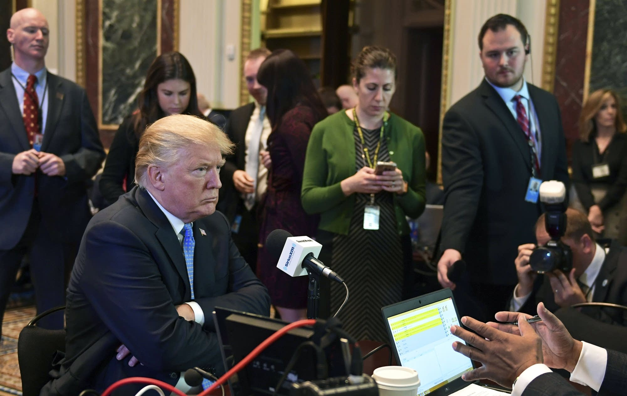 President Donald Trump sits for a radio interview.