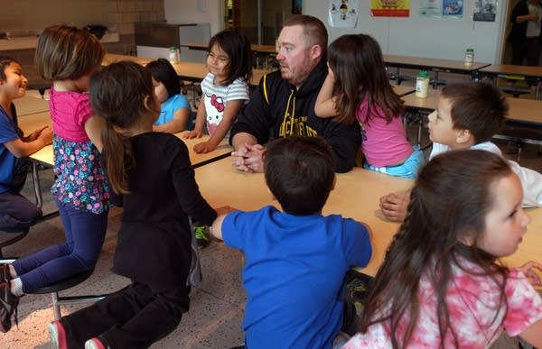Seth Houglum gathers his kindergarteners to get ready for lunch.