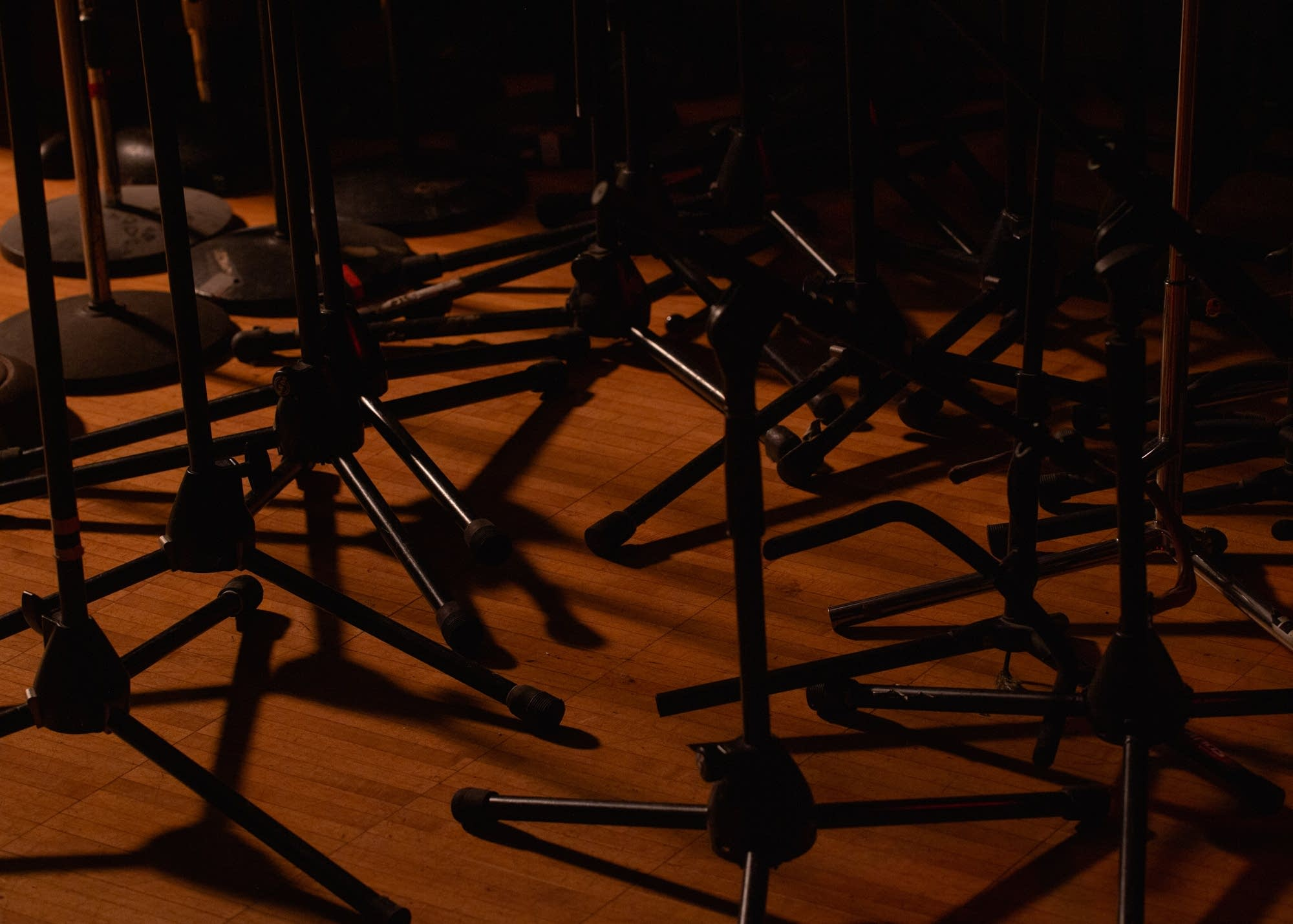 Unused mic stands are clustered together at the Cedar Cultural Center